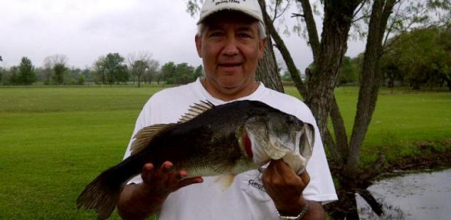 Tony Oviedo holds a nice bass caught from the shore at Matagorda Ashwood Palms.