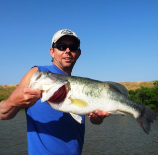 Clint Whittlock holds a 13.2 pound monster caught at Bowie Backside of the moon in early summer.