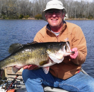 Mark Shirley holds a 13.7 lb bass caught at Oakwood Lake Leon.  We believe this is the lake record.  Nice fish Mark!