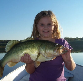 Brad Sheilds daughter landing a fish nearly as big as she is.